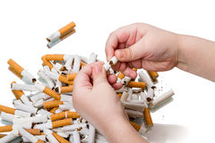 Child breaks a cigarette Royalty Free Stock Image