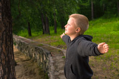 Child breathing in forest Stock Photo