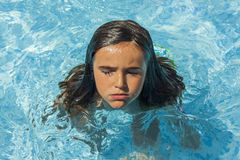 Child breathing while swimming in the pool. stock photography