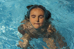Child breathing while swimming in the pool. royalty free stock photography
