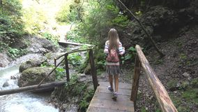 Child on Bridge in Mountains, Kid Hiking in Nature, Girl Looking a River, Stream royalty free stock photography