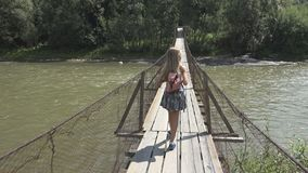 Child on Bridge in Mountains, Kid Hiking in Nature, Girl Looking a River, Stream stock photos