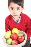 Child bring basket fruit. Child bringind basket fruit on white background Royalty Free Stock Images