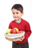 Child bring basket fruit Stock Photography