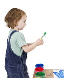 Child with brush and green paint Stock Images