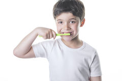 Child brushes his teeth. Happy child brushing her teeth Royalty Free Stock Image