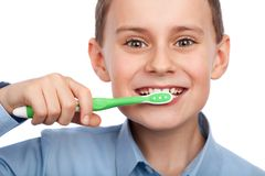 Child brushing his teeth Stock Image