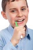 Child brushing his teeth Stock Images