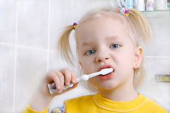 Child brushing teeth. In the bathroom Royalty Free Stock Photos