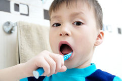 Child brushing teeth, boy dental care, oral hygiene concept, child in bathroom with tooth brush Stock Photos