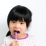 Child brushing teeth Stock Images