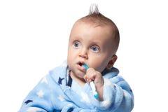 Child brushing teeth,  on white background Royalty Free Stock Photos
