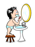 Child while brushing their teeth Royalty Free Stock Photo