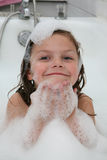 Child in bubble bath. Portrait of happy smiling child in bubble bath playing with soap bubbles Stock Photography