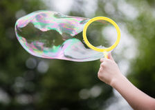 Child with bubble Stock Photography