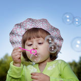 Child and bubble outdoors Stock Photos