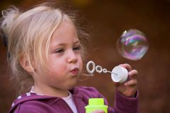 Child with bubbles Royalty Free Stock Photo