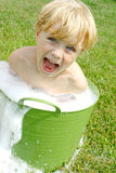 Child in Bubbly Wash Basin Royalty Free Stock Photos