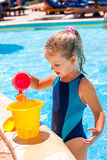 Child with bucket in swimming pool Royalty Free Stock Photography