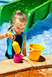 Child with bucket in swimming pool. Stock Photography