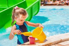 Child with bucket in swimming pool Royalty Free Stock Images