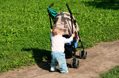 Child with buggy Royalty Free Stock Image