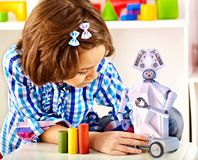 Child build robot toy. Kid engaged robotics in programming classes. Stock Photography