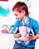 Child build robot toy. Kid engaged robotics in programming classes. Royalty Free Stock Images