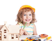 Child building house. Real estate agency concept Stock Images