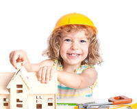 Child building house. Real estate agency concept Royalty Free Stock Photo