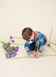 Child Building and Playing with Construction Set Pieces Royalty Free Stock Photography