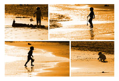 Child building sand castle. On the seashore Royalty Free Stock Image