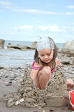 Child building sand castle Stock Photo