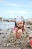 Child building sand castle Stock Photo