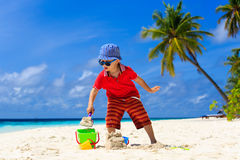 Child building sand castle on tropical beach Stock Images