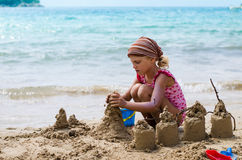 Child building a sand castles Stock Photos