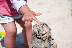 Child building sand tower Royalty Free Stock Photography