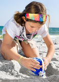 Child Building Sandcastle on a Beach Royalty Free Stock Photos