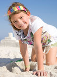 Child Building Sandcastle on a Beach Royalty Free Stock Photo