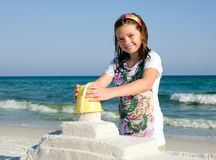 Child Building Sandcastle on a Beach Stock Photo