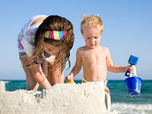 Child Building Sandcastle on a Beach Royalty Free Stock Images