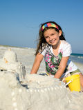 Child Building Sandcastle on a Beach Stock Image