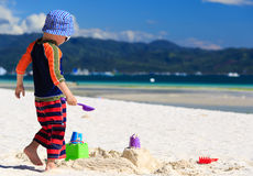Child building sandcastle Stock Image