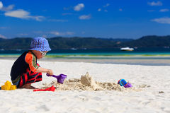 Child building sandcastle Stock Images