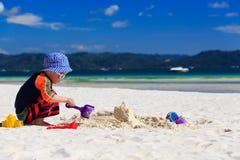 Child building sandcastle Stock Images