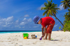 Child building sandcastle on the beach Royalty Free Stock Photography