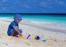 Child building sandcastle on the beach Stock Images