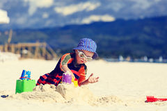 Child building sandcastle on the beach Royalty Free Stock Images