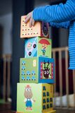 Child building tower from toy blocks