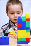 Child builds a tower Stock Photos